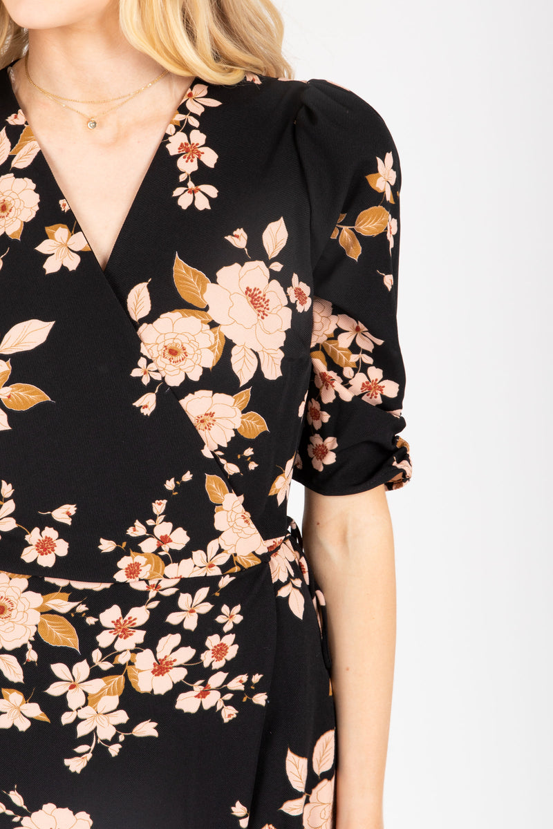 The Mattie Floral Wrap Dress in Black, studio shoot; closer up front view