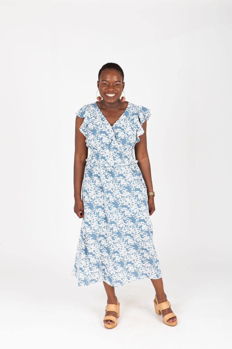 The Chance Floral Smocked Dress in Sky, studio shoot; front view