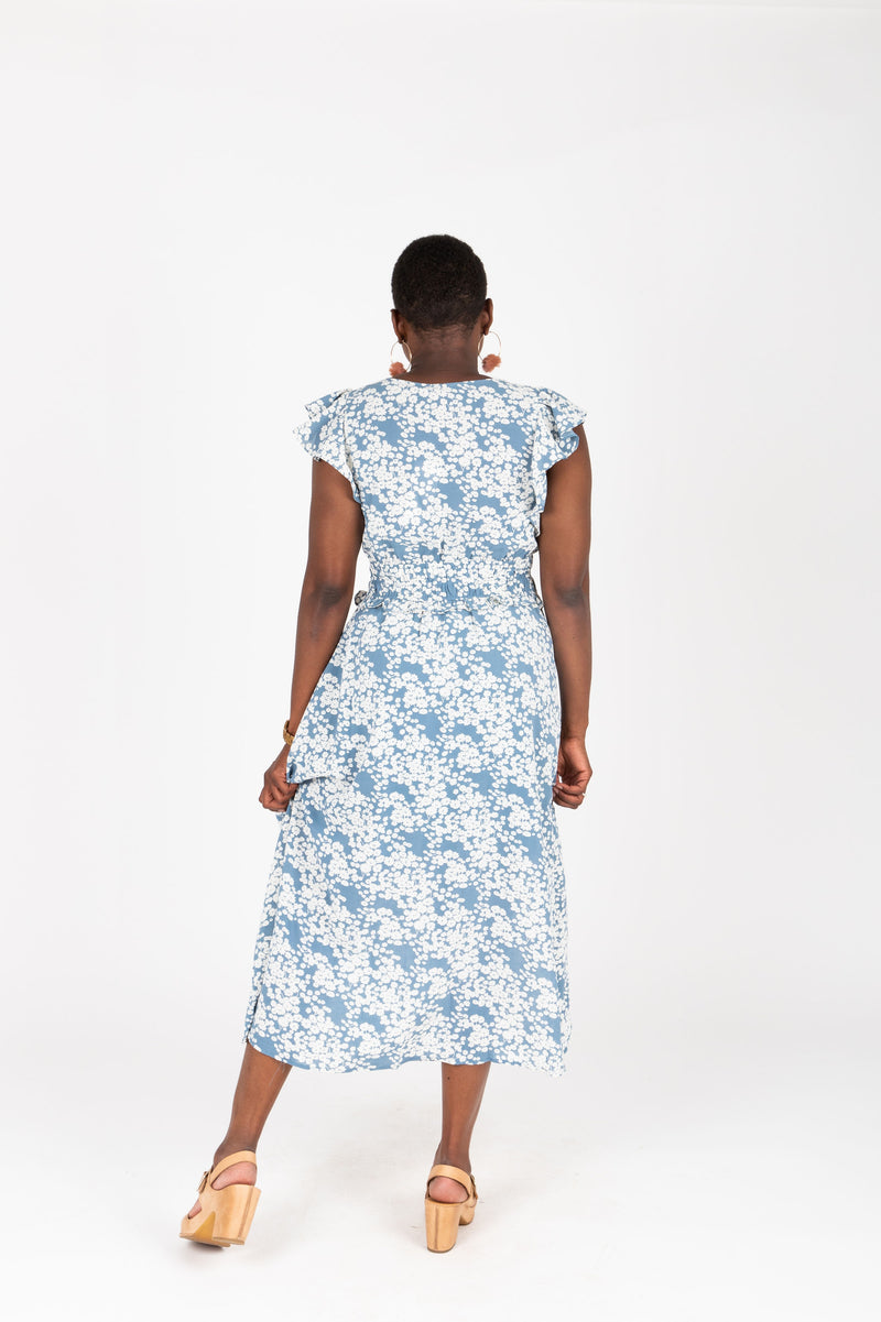The Chance Floral Smocked Dress in Sky, studio shoot; back view