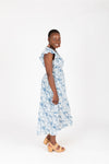 The Chance Floral Smocked Dress in Sky, studio shoot; side view