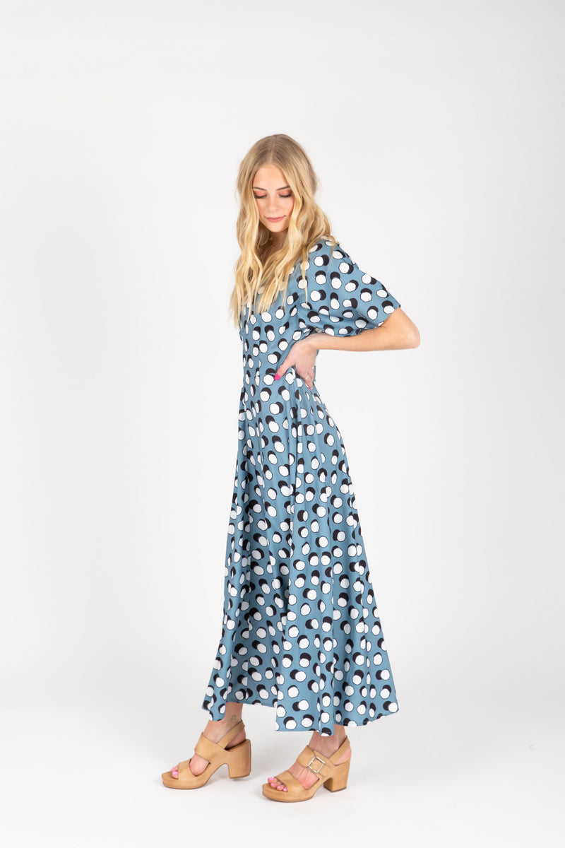 The Lively Patterned Maxi Dress in Blue, studio shoot; side view