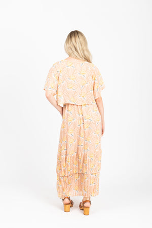 Piper & Scoot: The Firefly Floral Tiered Dress in Peachy Nude, studio shoot;  back view