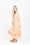 Piper & Scoot: The Firefly Floral Tiered Dress in Peachy Nude, studio shoot; side view