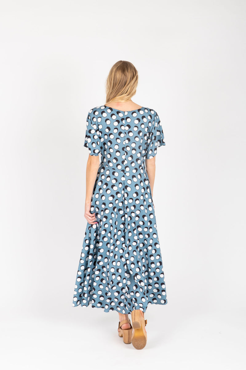 The Lively Patterned Maxi Dress in Blue, studio shoot; back view