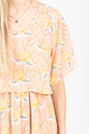 Piper & Scoot: The Firefly Floral Tiered Dress in Peachy Nude, studio shoot; close up front view