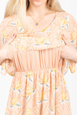 Piper & Scoot: The Firefly Floral Tiered Dress in Peachy Nude, studio shoot; close up front view to showcase nursing compatibility