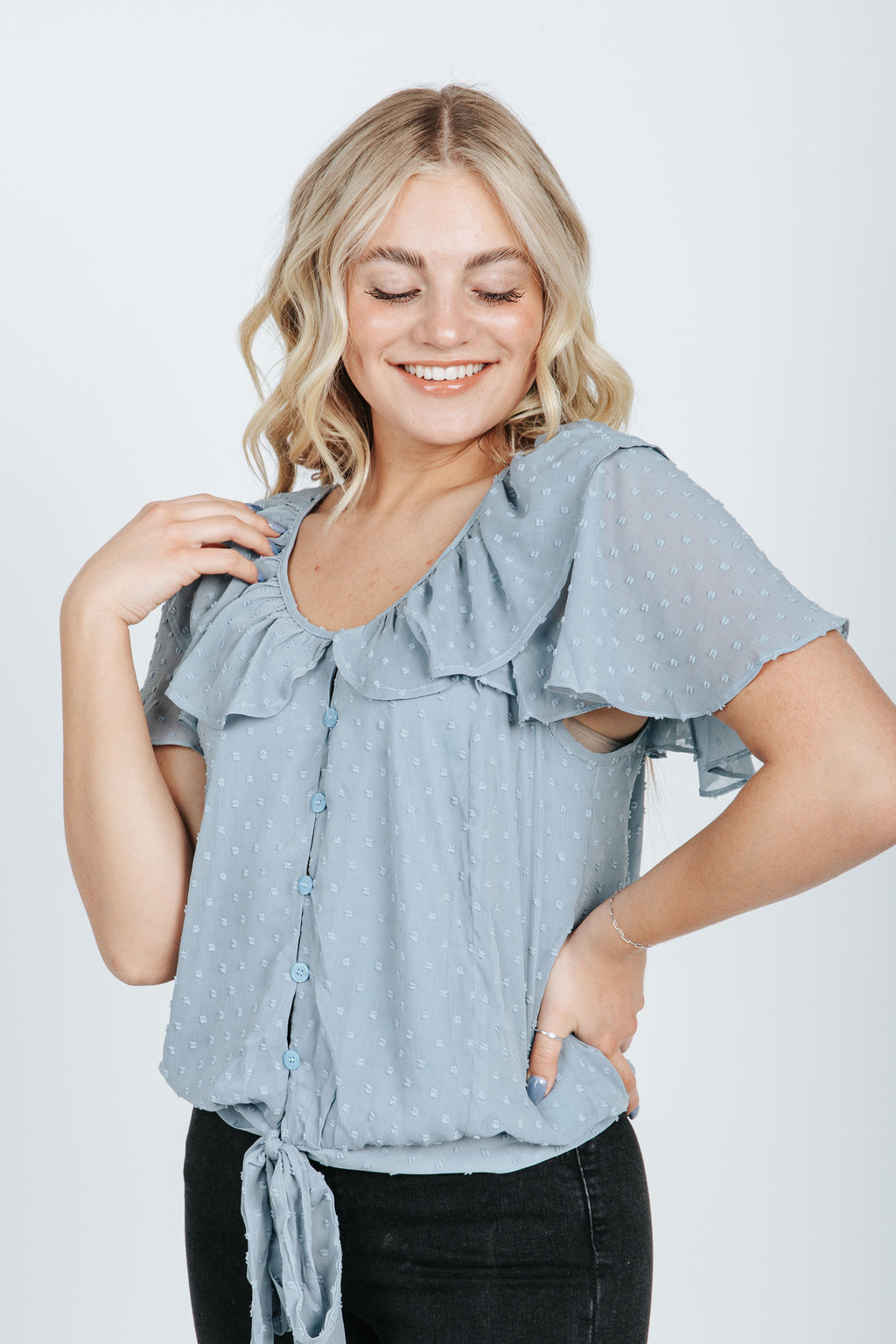 The Luke Swiss Dot Button Up Blouse in Dusty Blue, studio shoot; front view