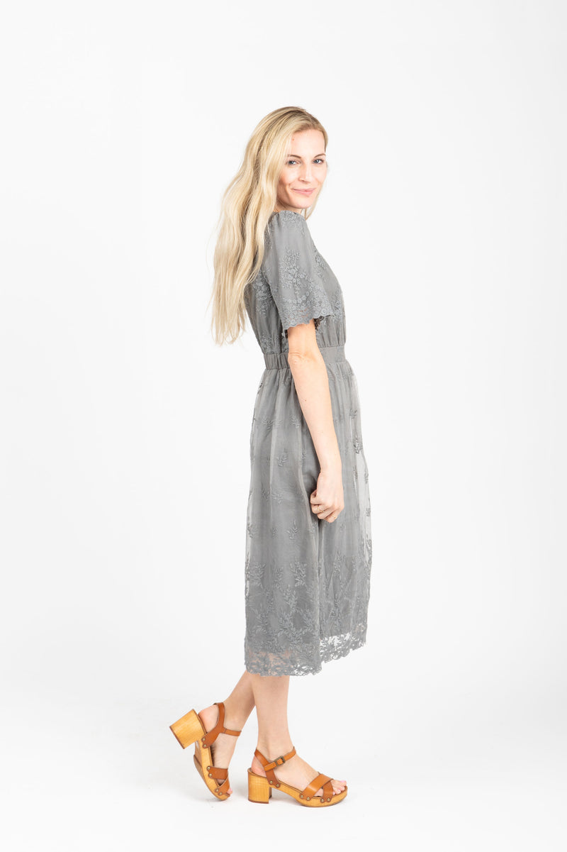 The Charming Lace Detail Dress in Grey, studio shoot; side view