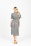 The Charming Lace Detail Dress in Grey, studio shoot; back view