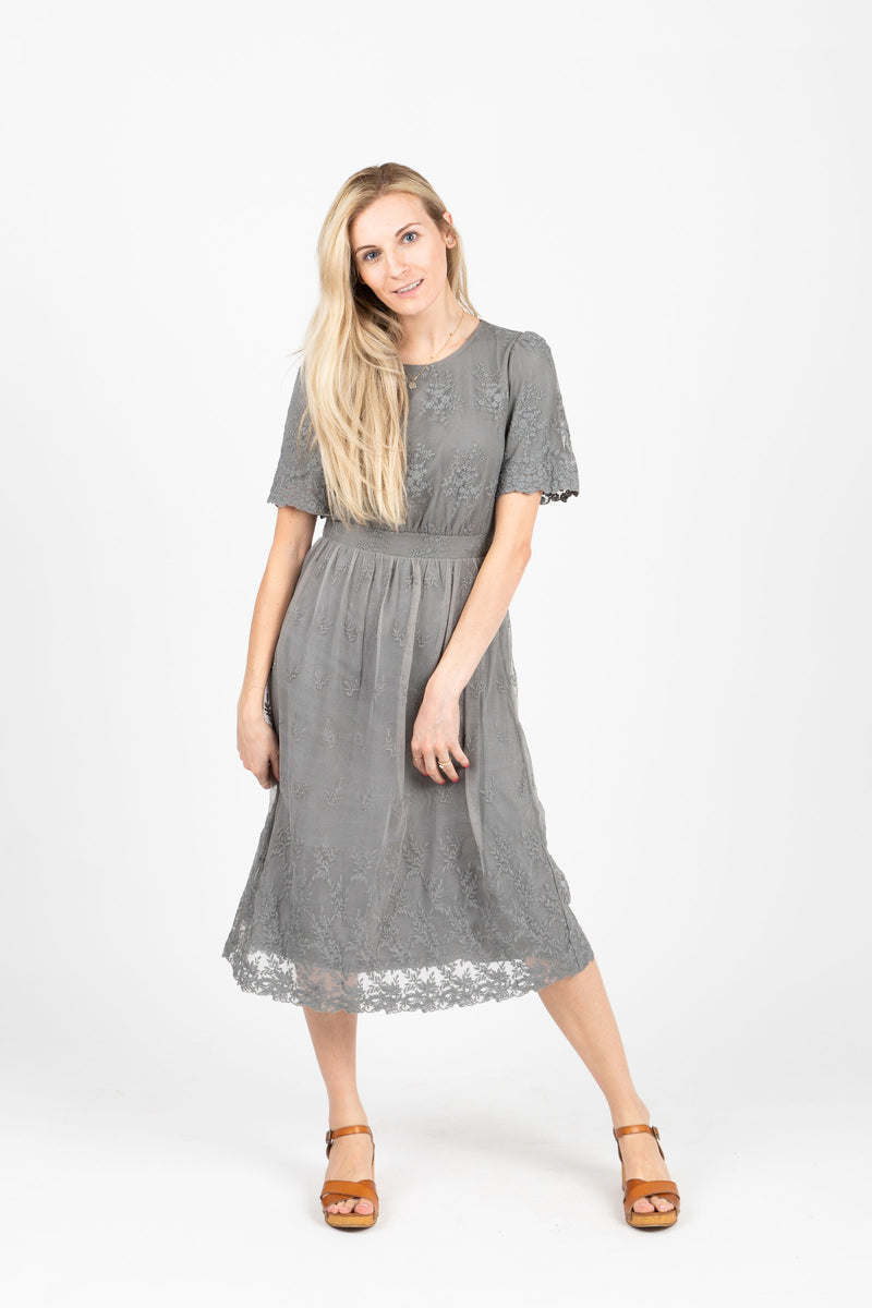 The Charming Lace Detail Dress in Grey, studio shoot; front view