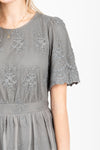 The Charming Lace Detail Dress in Grey, studio shoot; closer up front view