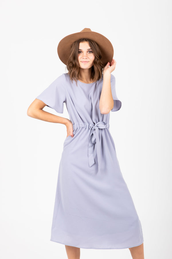 The Brendan Button Bib Dress in Dusty Lavender