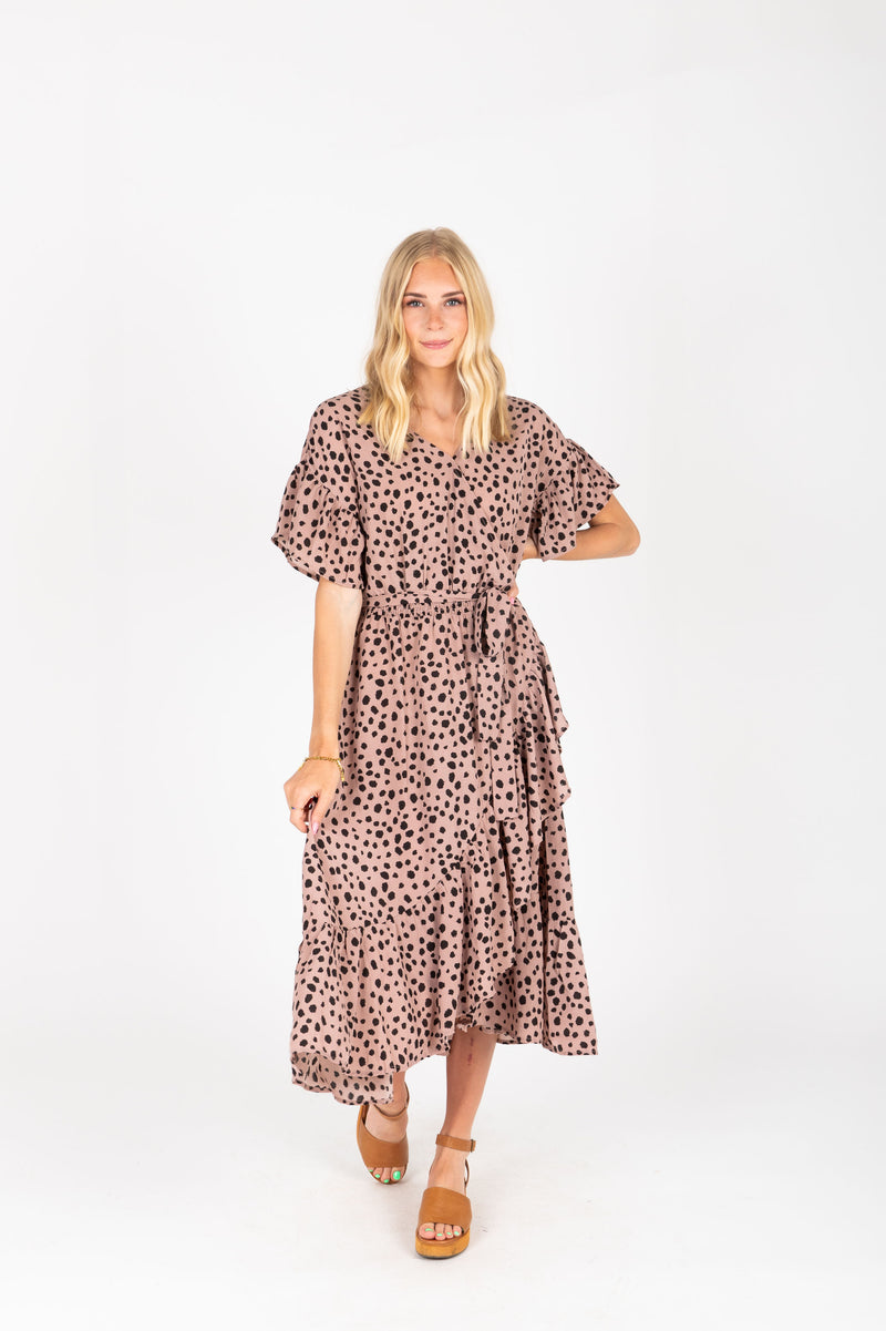The Brooks Wrap Front Patterned Dress in Mauve, studio shoot; front view