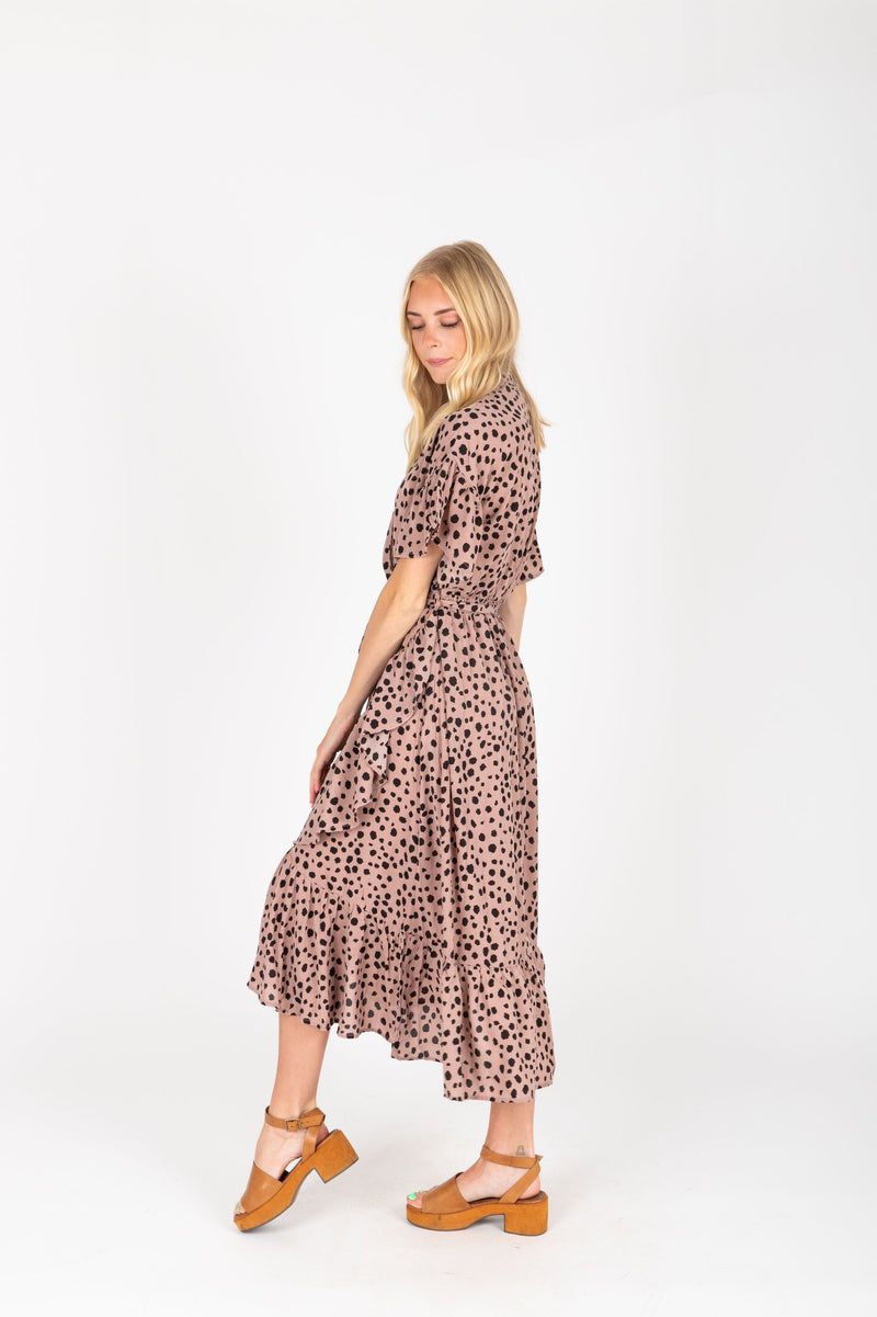 The Brooks Wrap Front Patterned Dress in Mauve, studio shoot; side view