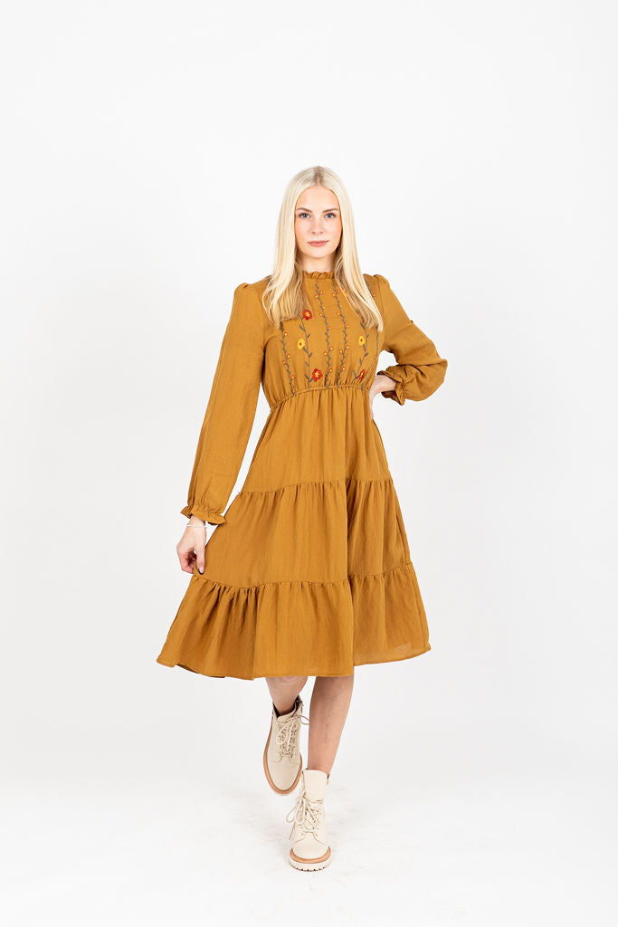 The Narcissa Embroidered Midi Dress in Camel, studio shoot; front view