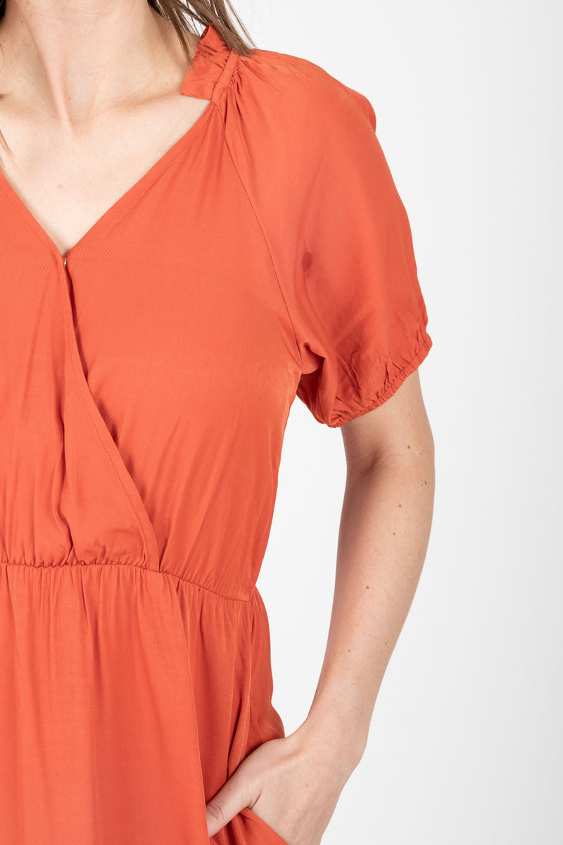 The Ingrid Ruffle Dress in Tangerine, studio shoot; closer up front view