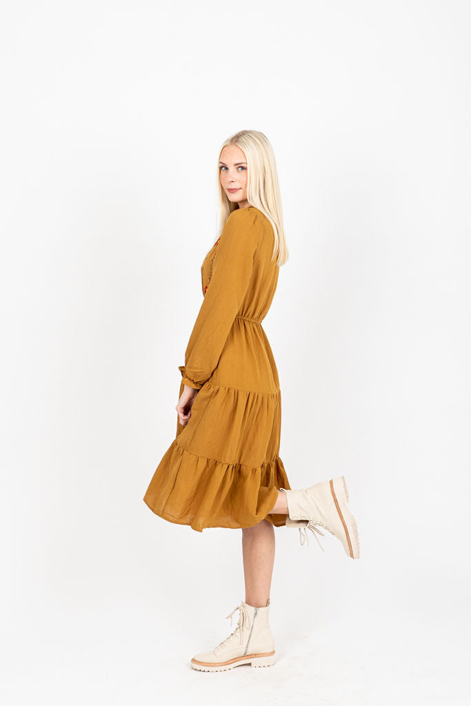 The Narcissa Embroidered Midi Dress in Camel, studio shoot; side view