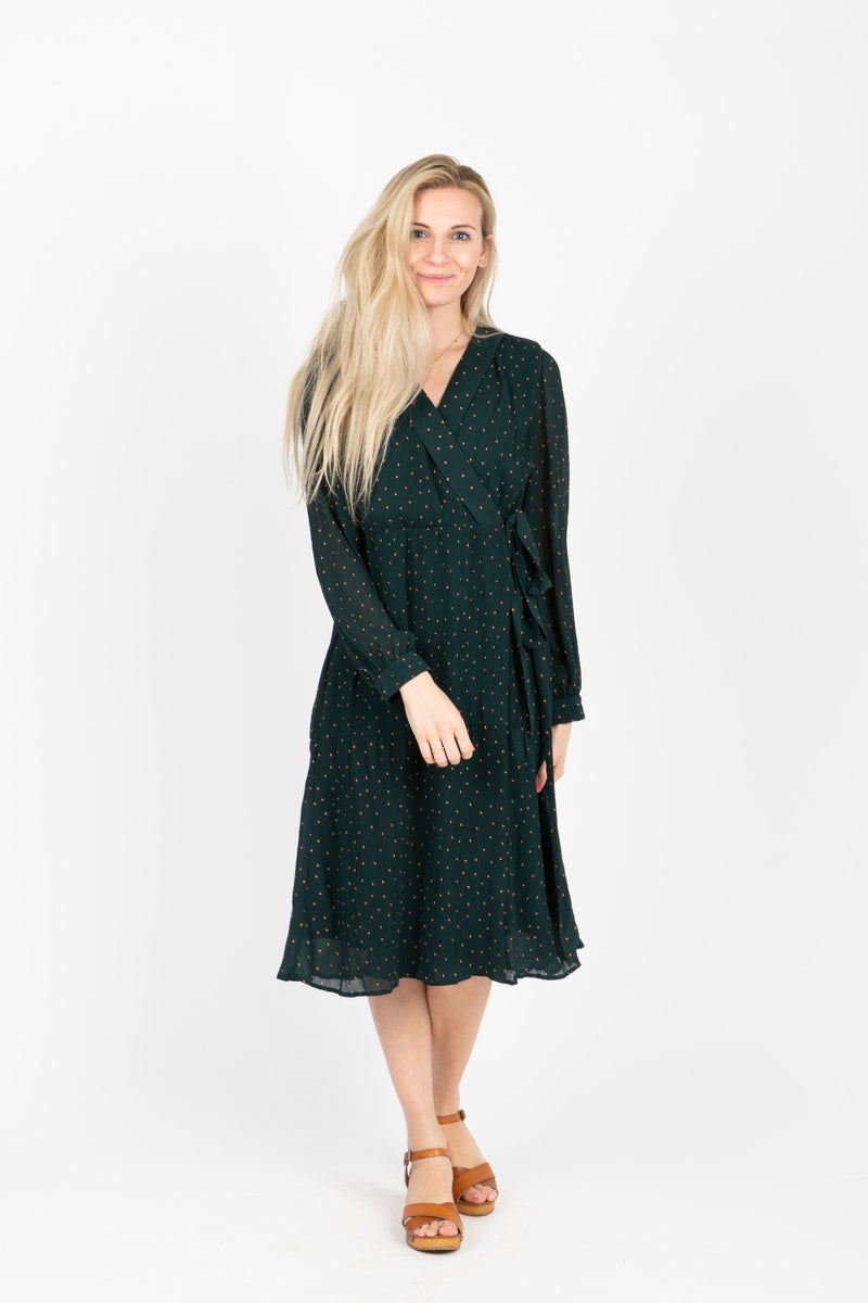 The Brisk Patterned Wrap Dress in Hunter Green, studio shoot; front view