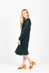 The Brisk Patterned Wrap Dress in Hunter Green, studio shoot; side view