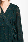 The Brisk Patterned Wrap Dress in Hunter Green, studio shoot; closer up front view