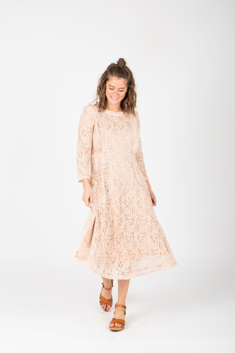 The Micah Lace Midi Dress in Blush, studio shoot; front view