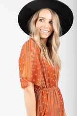 The Pemberton Patterned Ruffle Dress in Rust