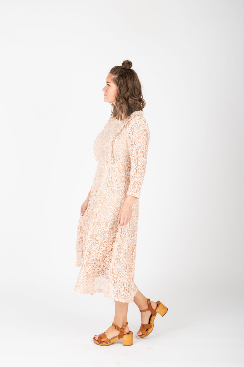 The Micah Lace Midi Dress in Blush, studio shoot; side view