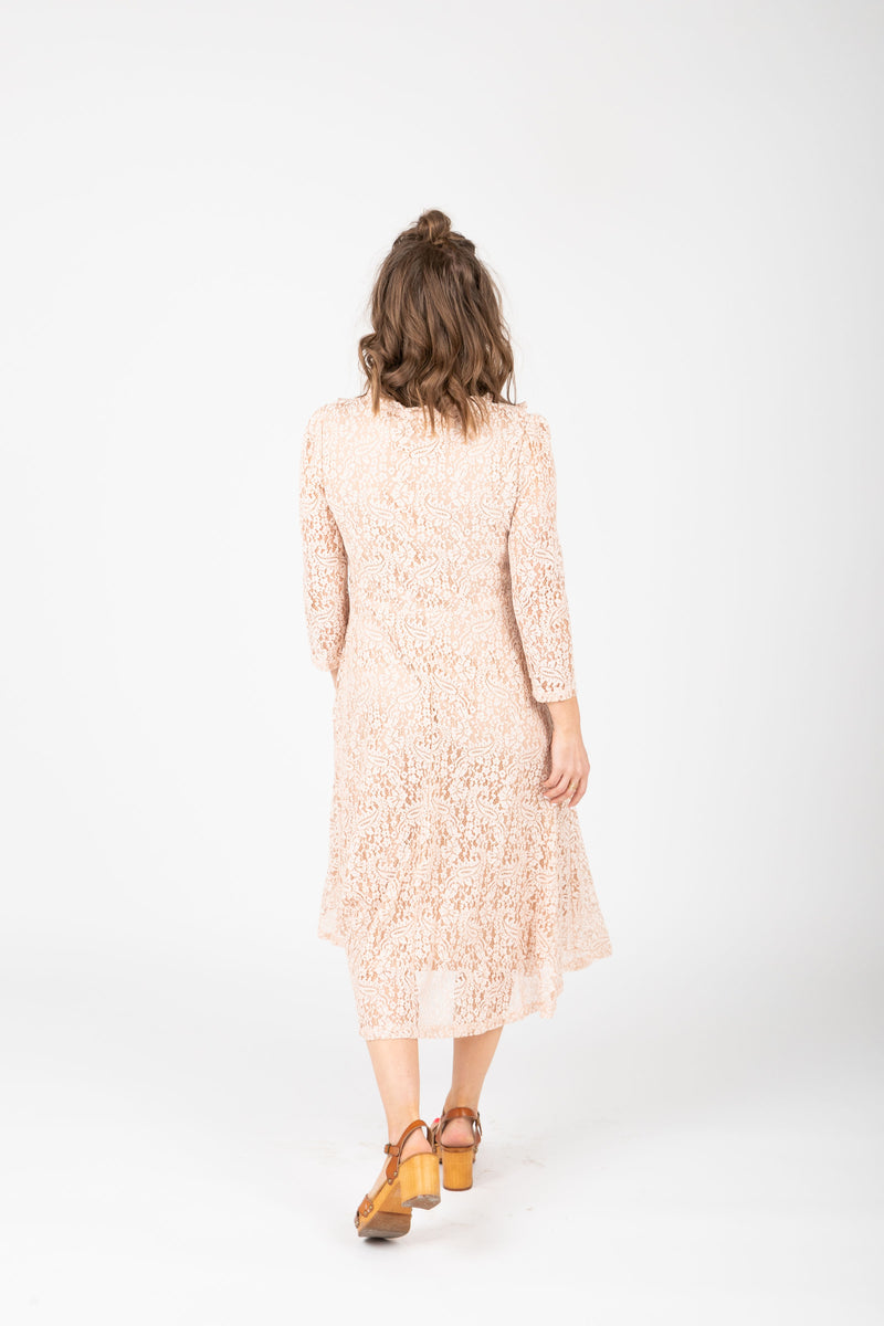 The Micah Lace Midi Dress in Blush, studio shoot; back view