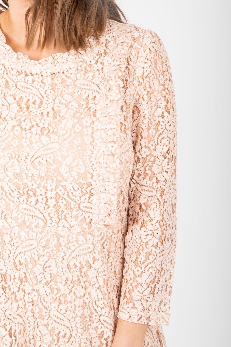 The Micah Lace Midi Dress in Blush, studio shoot; closer up front view