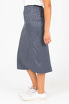 The Rylan Dot Silk Skirt in Blue, studio shoot; side view