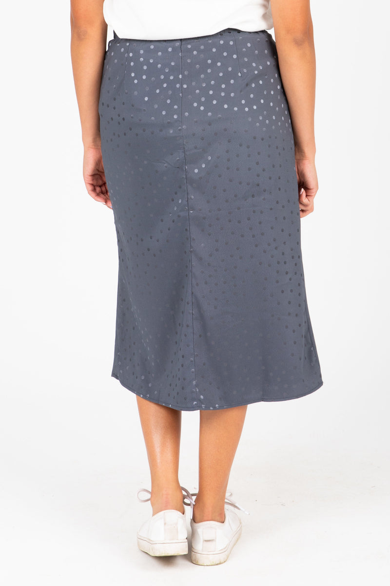 The Rylan Dot Silk Skirt in Blue, studio shoot; back view