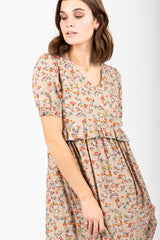 The Steen Floral Bib Maxi Dress in Taupe