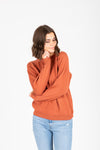 The Cabourn Casual Sweater in Brick, studio shoot; front view
