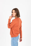 The Cabourn Casual Sweater in Brick, studio shoot; side view
