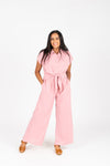 The Felix Tie Jumpsuit in Mauve, studio shoot; front view