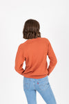 The Cabourn Casual Sweater in Brick, studio shoot; back view