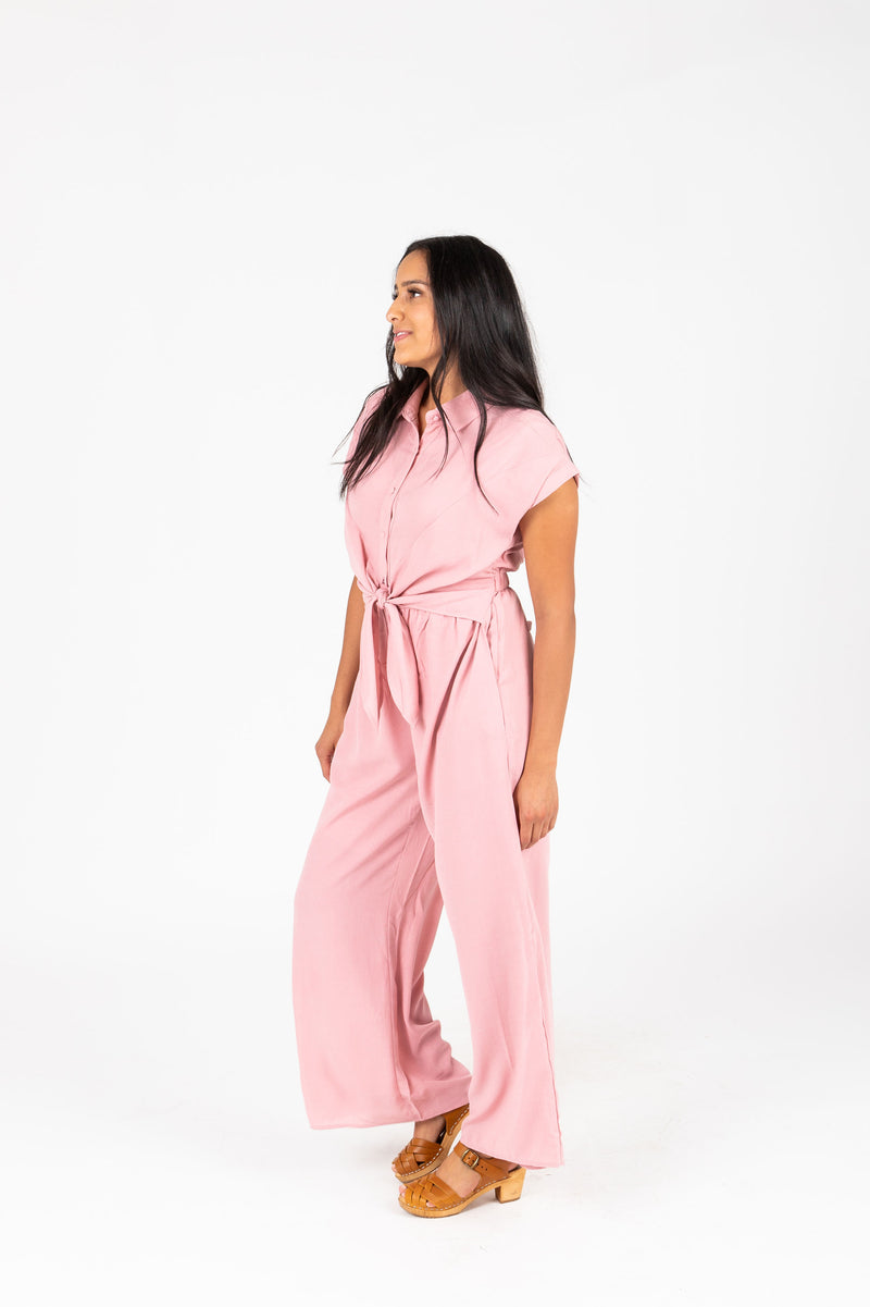 The Felix Tie Jumpsuit in Mauve, studio shoot; side view