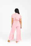 The Felix Tie Jumpsuit in Mauve, studio shoot; back view