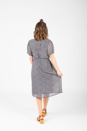 The Scout Floral Twist Detail Dress in Navy, studio shoot; back view