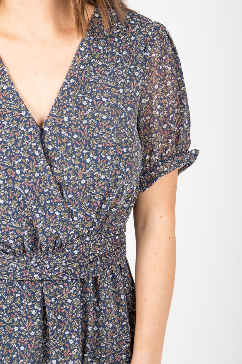 The Scout Floral Twist Detail Dress in Navy, studio shoot; closer up front view