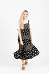 The Walter Tiered Floral Maxi Dress in Black, studio shoot; front view