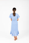 The Beckham Floral Wrap Dress in Periwinkle, studio shoot; back view