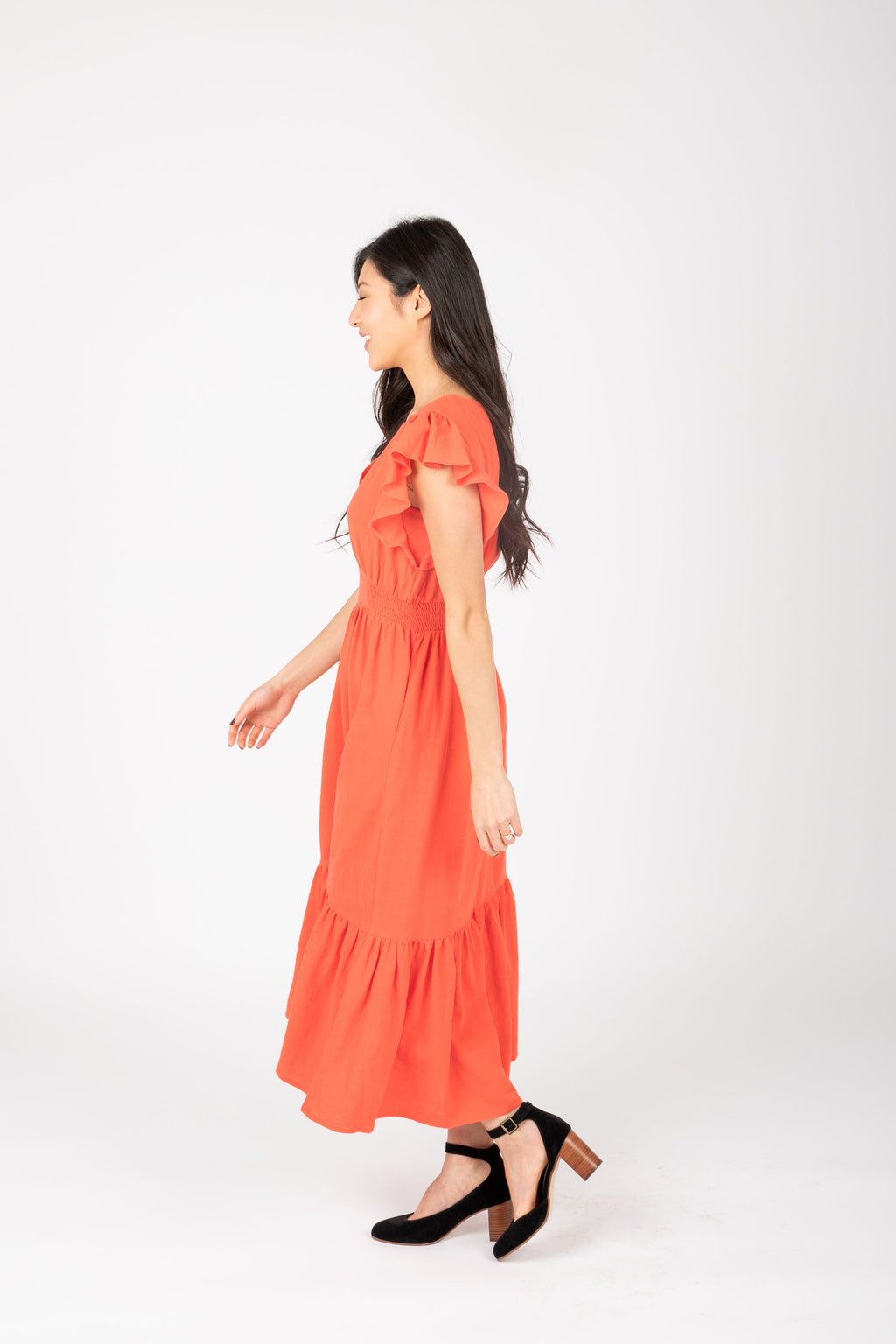 The Emmarie Ruffle Tiered Dress in Poppy, studio shoot; side view