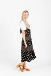 The Walter Tiered Floral Maxi Dress in Black, studio shoot; side view