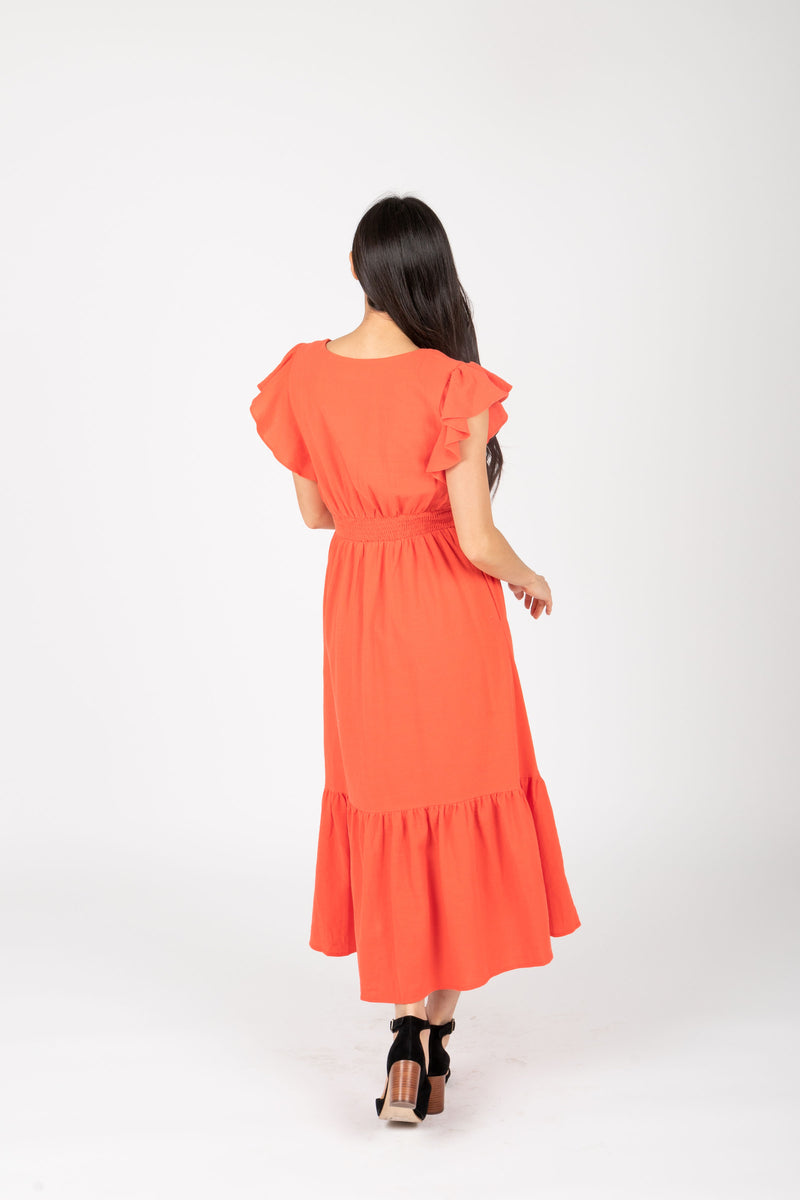 The Emmarie Ruffle Tiered Dress in Poppy, studio shoot; back view