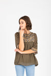 The Punch Embroidered Empire Blouse in Olive, studio shoot; front view