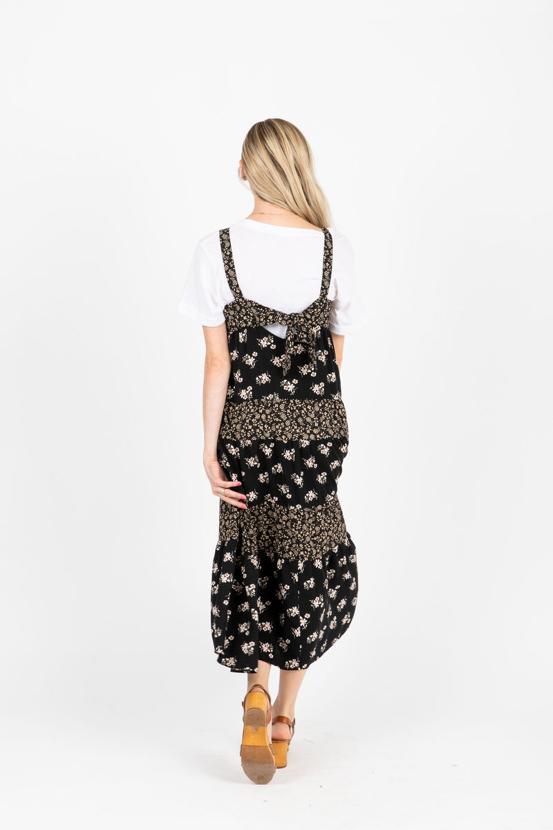 The Walter Tiered Floral Maxi Dress in Black, studio shoot; back view