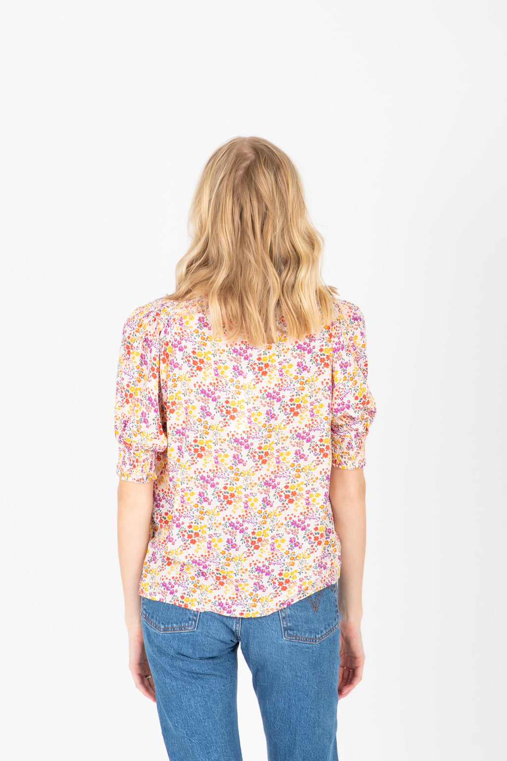 The Charlotte Floral Button Blouse in Multi, studio shoot; back view