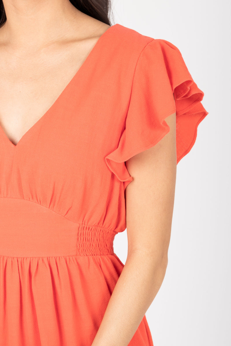 The Emmarie Ruffle Tiered Dress in Poppy, studio shoot; closer up front view
