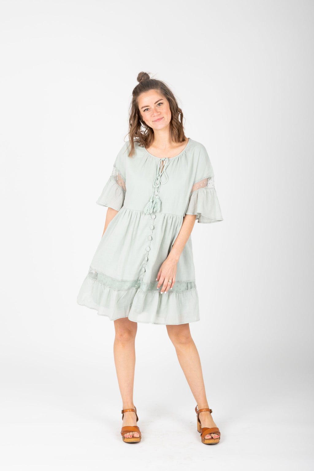 The Tinley Ruffle Detail Dress in Sage, studio shoot; front view